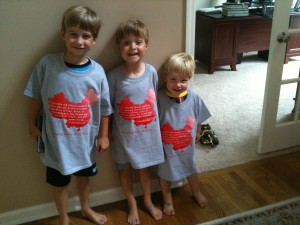 The boys in their adoption shirts