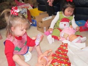 Little girls feeding their babies
