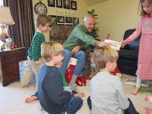 Papa passing out stockings