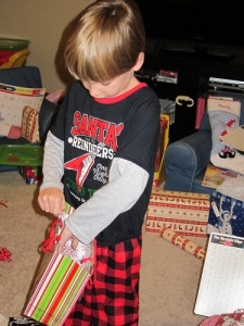 Carter opening gifts